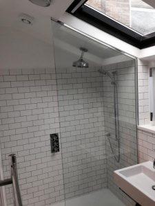Glass shower enclosure alcove